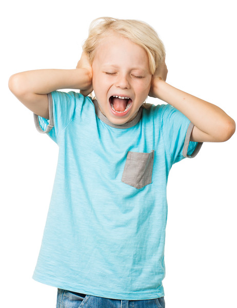 Young boy screams and covers ears