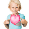 Cute young boy holding love heart