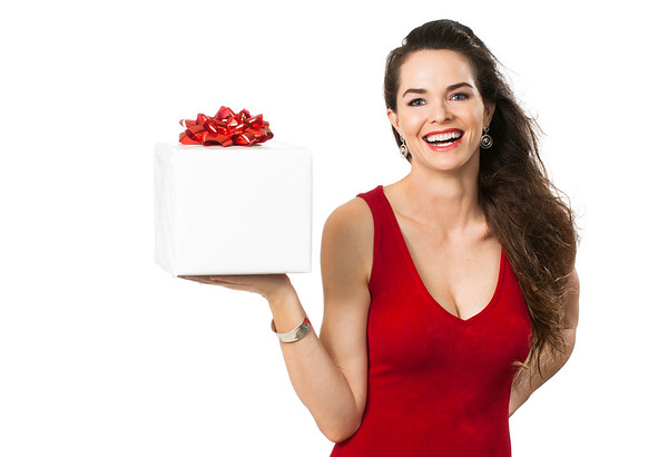 Attractive happy woman holding wrapped gift