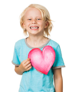 Happy young boy holding love heart