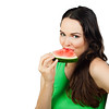 Healthy woman eating water melon
