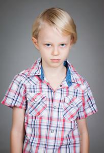 Sad grumpy young boy