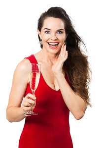 Surprised woman holding glass of champagne