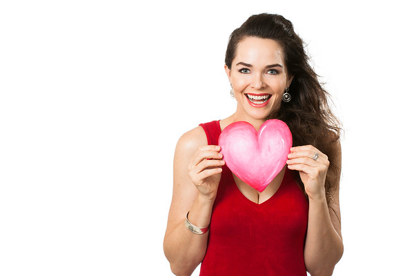Beautiful happy woman holding red love heart.