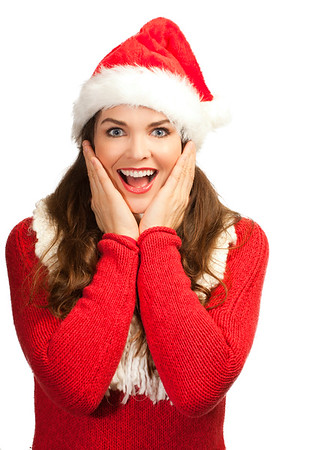 Surprised beautiful woman in santa hat