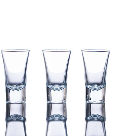 Three empty shot glasses