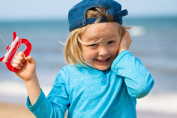 Happy cute boy flying kite