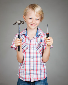 Cute boy hammer and screwdriver
