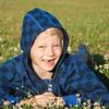 Happy boy lying in grass smiling