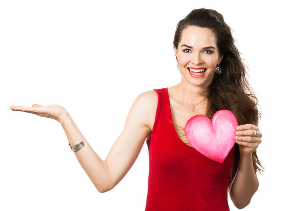 Beautiful woman holding red love heart.