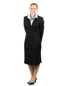 Portrait of friendly young air hostess