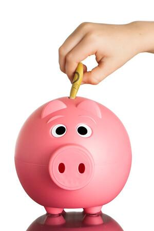 Pink piggy bank with Australian dollars