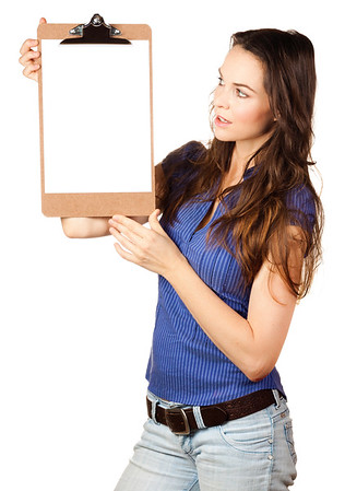 Beautiful woman looking at blank clipboard