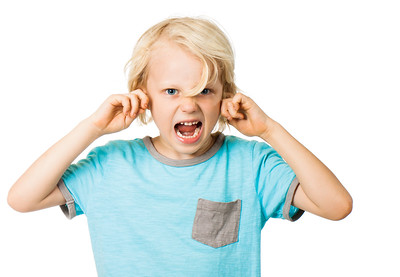 Boy screaming and blocking ears
