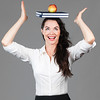 Woman balancing apple and books on head