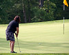 Stephany Powell of Springfield uses her putter from the fringe on this fast downhill putt....