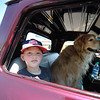 Waylon Letarte, 10, of Lunenburg alongside a dog named Apache sit inside a 65 Chevy at Monty Tech in Westminster on Sunday for the Mid State Antique & Classic Auto Meet.  SENTINEL & ENTERPRISE JEFF PORTER