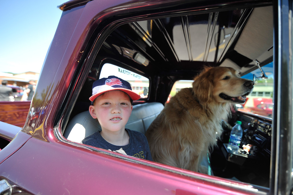 . Waylon Letarte, 10, of Lunenburg alongside a dog named Apache sit inside a 65 Chevy at Monty Tech in Westminster on Sunday for the Mid State Antique & Classic Auto Meet.  SENTINEL & ENTERPRISE JEFF PORTER