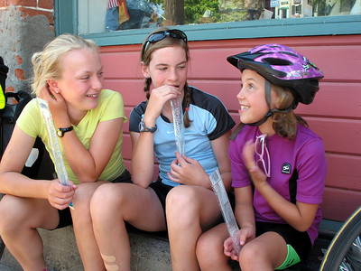 Katelyn, Maddy, and Nellie finish their popsicles