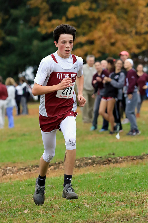 . Mid-Wach B boys cross country championships where held at Hollis Hills Farm in fitchburg on Thursday afternoon. Fitchburg High School\'s Zach Scott competes in the race. SENTINEL & ENTERPRISE/JOHN LOVE