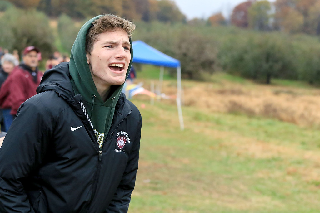 . Mid-Wach B girls cross country championships where held at Hollis Hills Farm in fitchburg on Thursday afternoon. Groton Dunstable Regional High School senior Grant Willsie cheers on the girls team during the meet.  SENTINEL & ENTERPRISE/JOHN LOVE