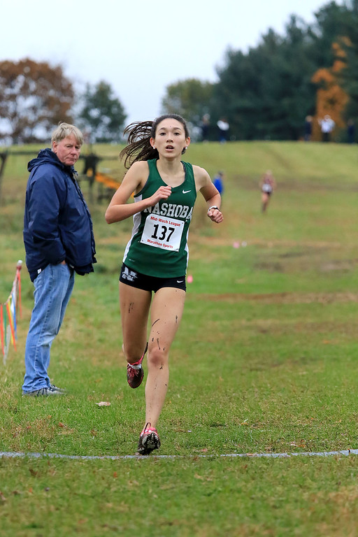 . Mid-Wach B girls cross country championships where held at Hollis Hills Farm in fitchburg on Thursday afternoon. Nashoba Regional High School\'s Alexandra Bettez wins the race. SENTINEL & ENTERPRISE/JOHN LOVE
