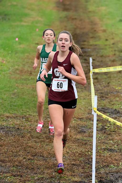 . Mid-Wach B girls cross country championships where held at Hollis Hills Farm in fitchburg on Thursday afternoon. Groton Dunstable Regional High School\'s Sarah Maple competes in the race. SENTINEL & ENTERPRISE/JOHN LOVE