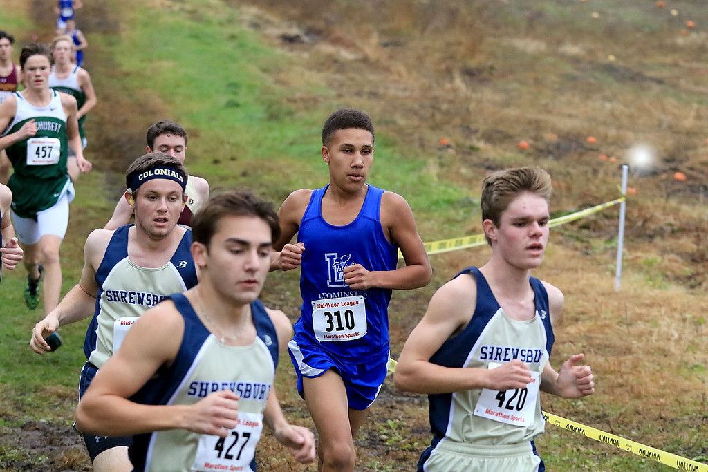 . Mid-Wach A boys cross country championships where held at Hollis Hills Farm in fitchburg on Thursday afternoon. Leominster High School\'s Jayden Kinthua competes in the race. SENTINEL & ENTERPRISE/JOHN LOVE