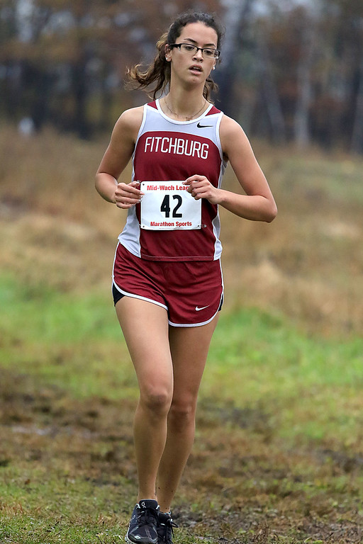. Mid-Wach B girls cross country championships where held at Hollis Hills Farm in fitchburg on Thursday afternoon. Fitchburg High School\'s Tiana Muniz competes in the race. SENTINEL & ENTERPRISE/JOHN LOVE