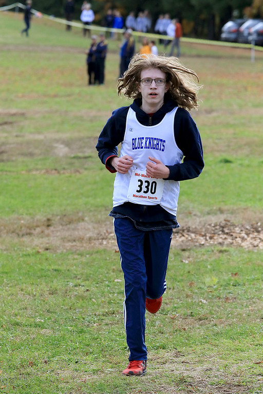 . Mid-Wach D boys cross country championships was held at Hollis Hills Farm in Fitchburg on Wednesday afternoon, October 31, 2018. Lunenburg High School runner Calvin Wuorinen competes in the race. SENTINEL & ENTERPRISE/JOHN LOVE