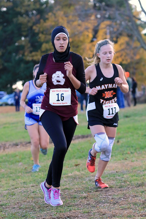 . Mid-Wach E girls cross country championships was held at Hollis Hills Farm in Fitchburg on Wednesday afternoon, October 31, 2018. Ayer Shirley Regional High School runner Zineb Majoudou competes in the race. SENTINEL & ENTERPRISE/JOHN LOVE