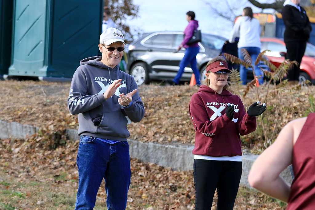 . Mid-Wach E boys cross country championships was held at Hollis Hills Farm in Fitchburg on Wednesday afternoon, October 31, 2018. Amy and Jim VanGilder cheer for an Ayer Shirley Regional High School runner as her finishes the race. SENTINEL & ENTERPRISE/JOHN LOVE