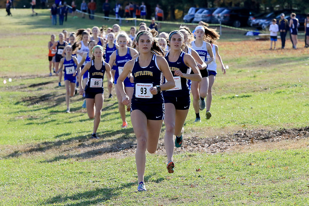 . Mid-Wach D girls cross country championships was held at Hollis Hills Farm in Fitchburg on Wednesday afternoon, October 31, 2018. Leading the way at the start of the race is Littleton High School runners Sarah Roffman and  her twin sister Kaitlyn Roffman. SENTINEL & ENTERPRISE/JOHN LOVE