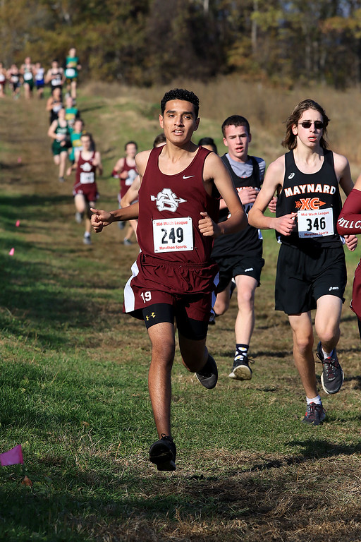 . Mid-Wach E boys cross country championships was held at Hollis Hills Farm in Fitchburg on Wednesday afternoon, October 31, 2018. Ayer Shirley Regional High School Runner Brandon Morales competes in the race. SENTINEL & ENTERPRISE/JOHN LOVE