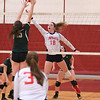 North Midd Maddie Harrington hits as Brie Donohue Nashoba blocks