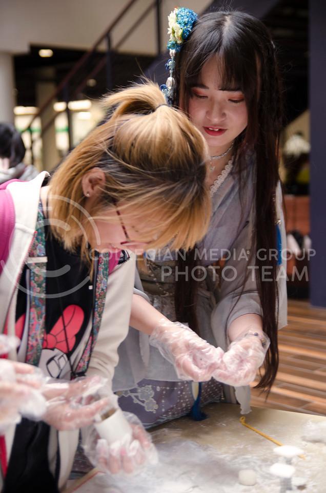 Jiayue Bian, Jiahui Xue and Caiyun Zheng participate in Mid-autumn Chinese festival at K-State Union on October 4, 2017 (Saya Kakim| Collegian Media Group)