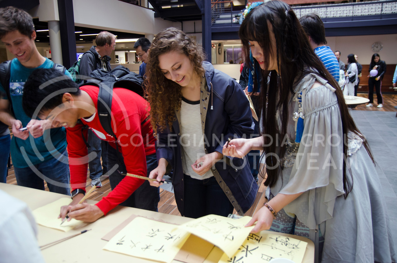 Jiayue Bian and Taryn Borelli participate in Mid-autumn Chinese festival at K-State Union on October 4, 2017 (Saya Kakim| Collegian Media Group)
