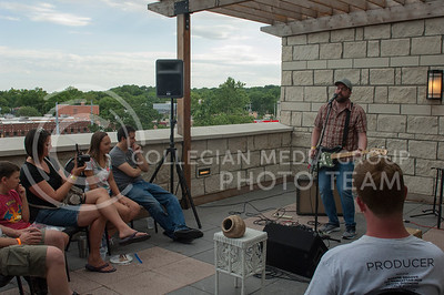 David Spiker preforms during the Mid by Midwest music festival in Manhattan, Kan. on June 24, 2017. A lineup of over 20 performanced on two stages at the top floor of Bluemont Hotel. (Justin Wright | The Collegian)