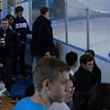 Coaches, skaters, and onlookers during practice.  There's Timmmmmaaaaay