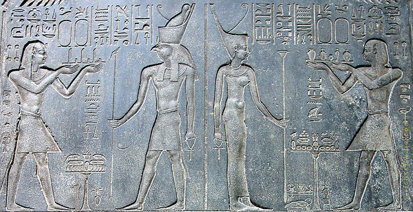 wearing two crowns (the swoop backed, and bowling pin crowns symbolizing upper and lower egypt)