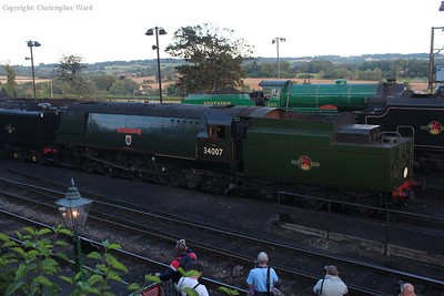 34007 backs over the pit in tandem with the 9F