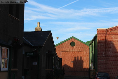 A hot air balloon rises above Ropley station