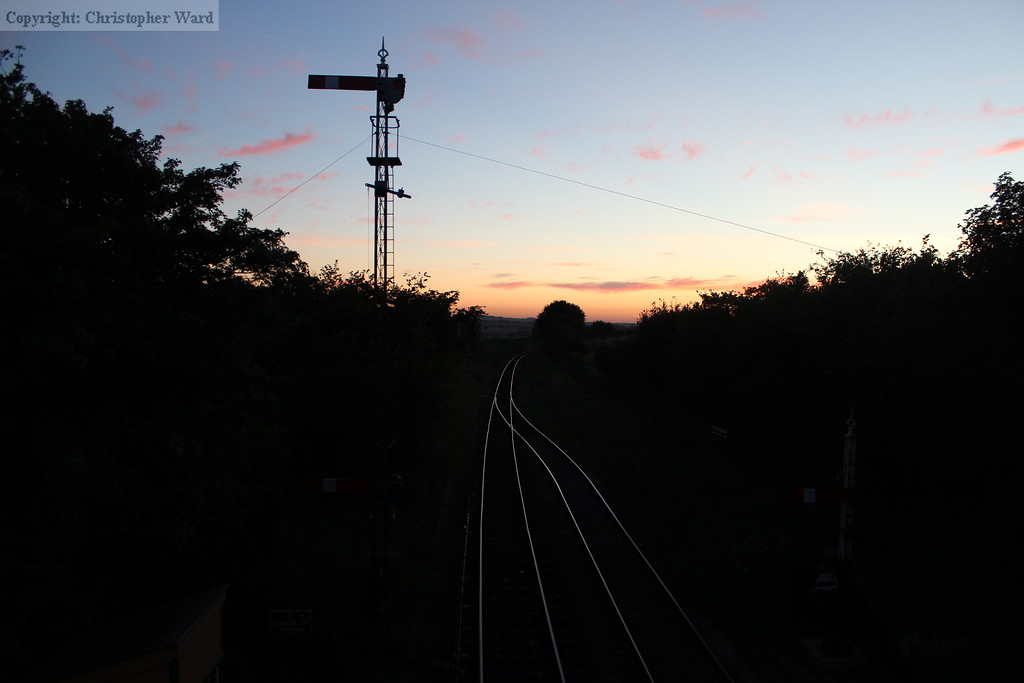 The line to Alresford snakes away under the sunset
