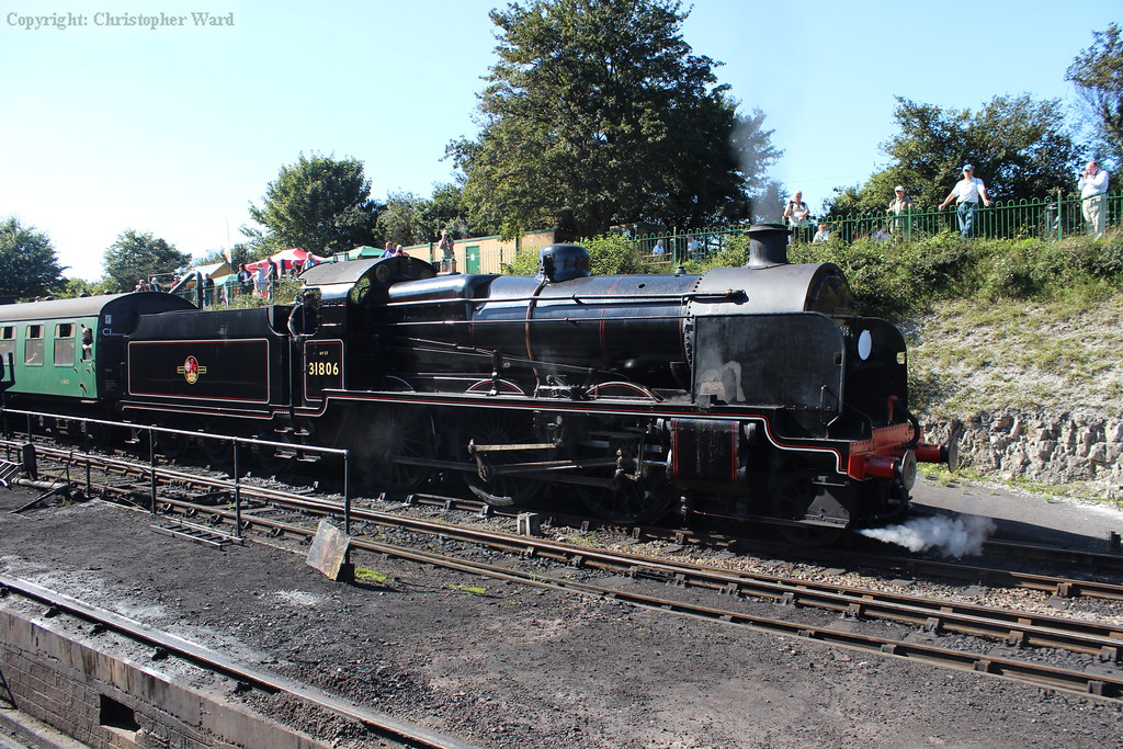 31806 pulls out of Ropley