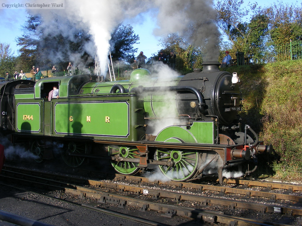 1744 gets to grips with its train at Ropley