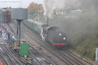 Shrouded in her own steam, the U class gets underway with an Alton train