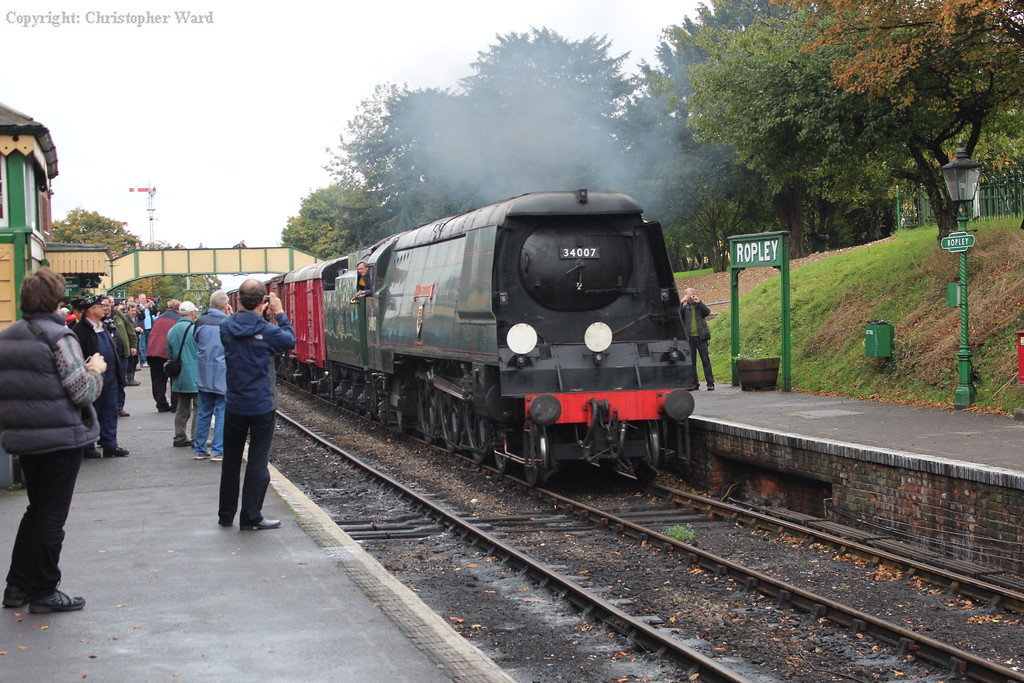 34007 pulls into Ropley with a train of restored vans