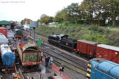 31806 scurries through the approaches to Ropley station with the goods train