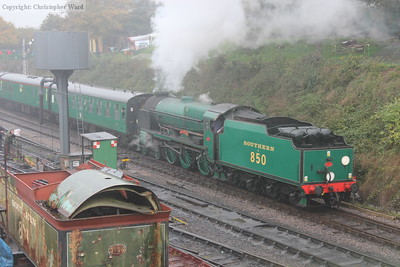 Lord Nelson passes the tender of 828 (another engine synonymous with Eastleigh)
