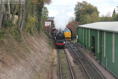 The 9F passes the class 37 in the headshunt and bears down on Ropley